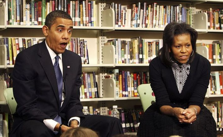 President Barack Obama, left, and his wife, first lady Michelle Obama, visit second graders at Capital City Public Charter School in Washington, Tuesday, Feb. 3, 2009. (AP Photo/Pablo Martinez Monsivais)