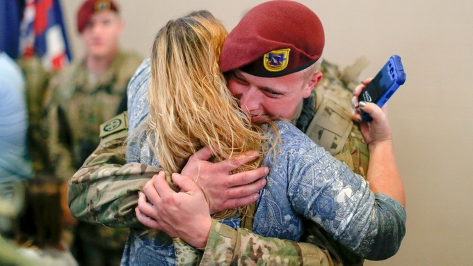 Zachary Smith, a paratrooper with the 1st Brigade Combat Team, 82nd Airborne Division, hugs his mom Angie Gibson after returning home from Afghanistan. Credit: Reuters