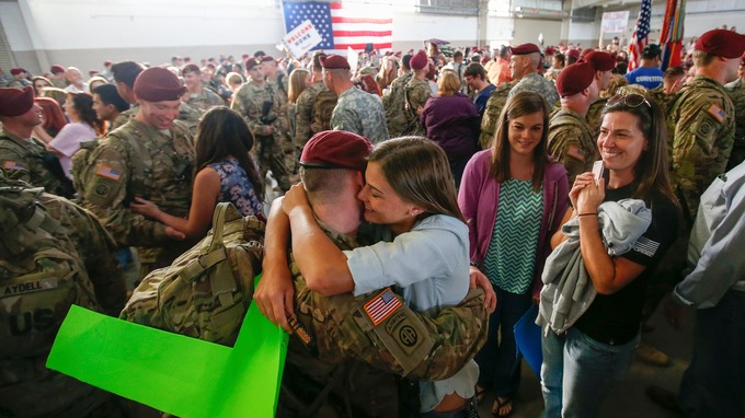 John Jacoby, a paratrooper, hugs his girlfriend Emiliee Chance after returning home from Afghanistan. Credit: Reuters