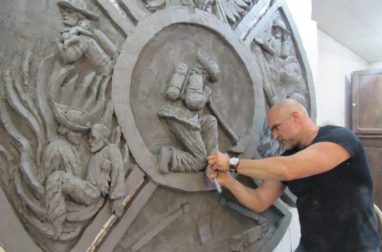 Artist Tim Schmalz works on the Fort McMurray sculpture in his Ontario studio.