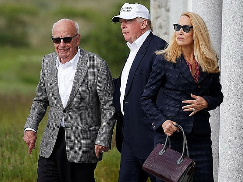 Donald Trump with Rupert Murdoch and his wife, Jerry Hall.