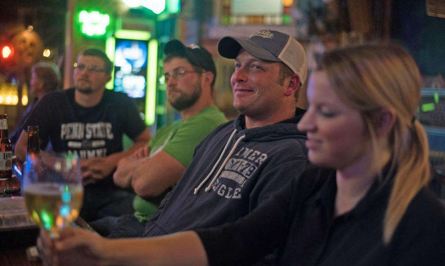 Ken Reed (second from right), and Kady Letosky (right) watch the presidential debate at the Tin Lizzy in Youngstown, Pa. Credit: Justin Merrimen/New York Post