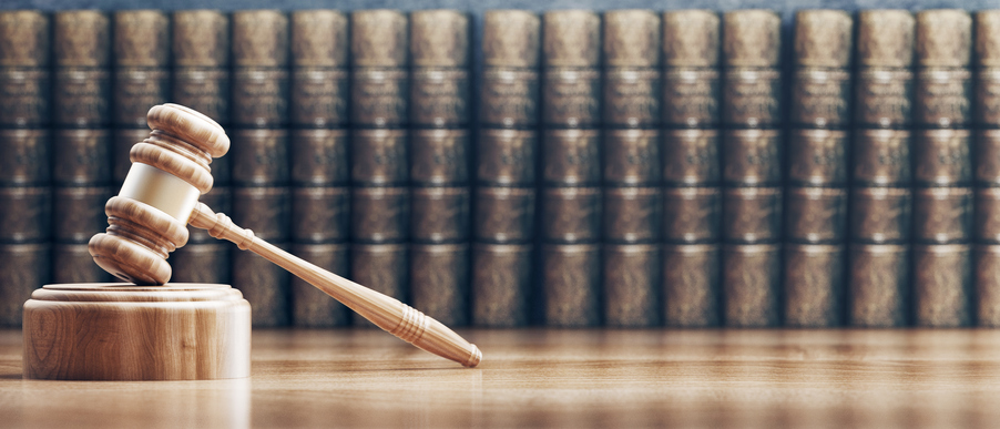 Crazy laws that are real: Close-Up Of Wooden Gavel Against Books On Table