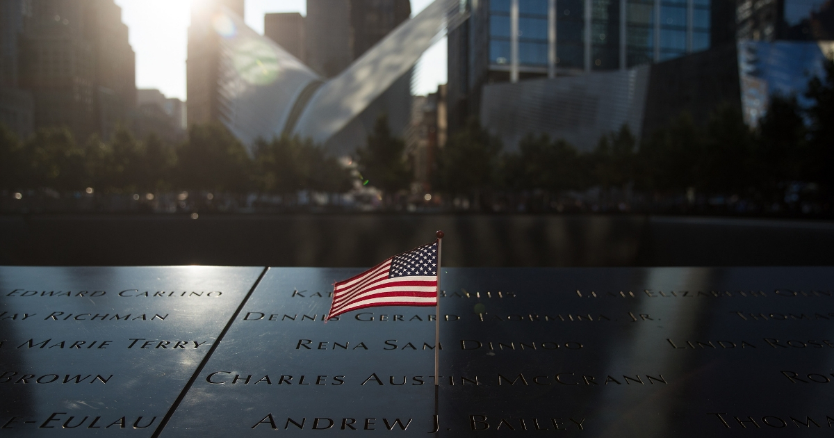 An American flag is left at the north pool memorial site before a commemoration ceremony for the victims of the Sept. 11, 2001, terrorist attacks at the National 9/11 Memorial in New York City.
