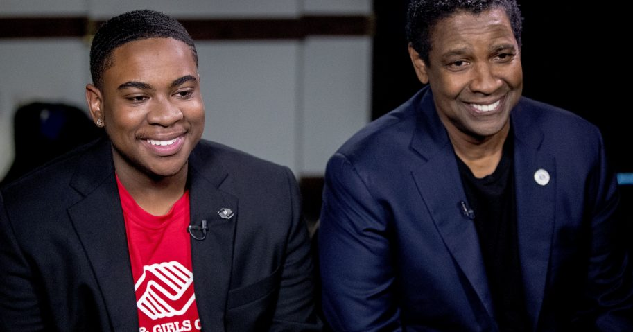 Actor Denzel Washington, right, and Malachi Haynes appear at an interview last week at the National Press Club in Washington.