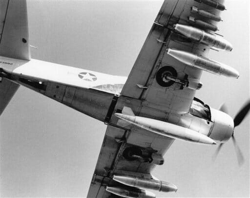 A propeller-driven A-1 Skyraider fighter-bomber carries bombs and napalm on a combat mission, April 1965.