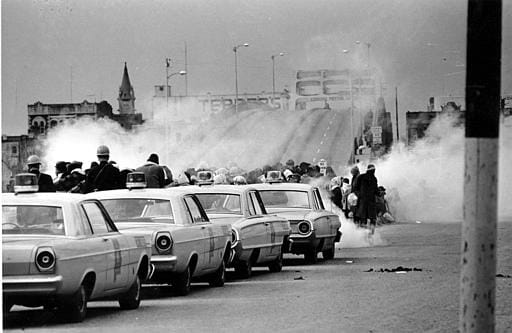 Tear gas fumes fill the air as state troopers, ordered by Gov. George Wallace, break up a demonstration march in Selma, Alabama, on what is known as Bloody Sunday on March 7, 1965.