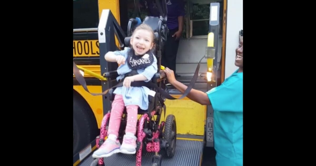 Little Girl with Cerebral Palsy Has Joyous Reaction While Boarding Bus for First Day of School