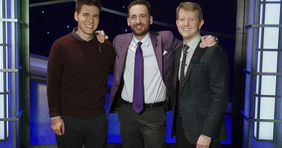 "Contestants, from left, James Holzhauer, Brad Rutter and Ken Jennings appear on the set of ""Jeopardy!"" in Los Angeles."