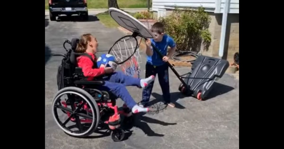 Video of Brother Helping His Sister Score Basket Goes Viral for All the Right Reasons